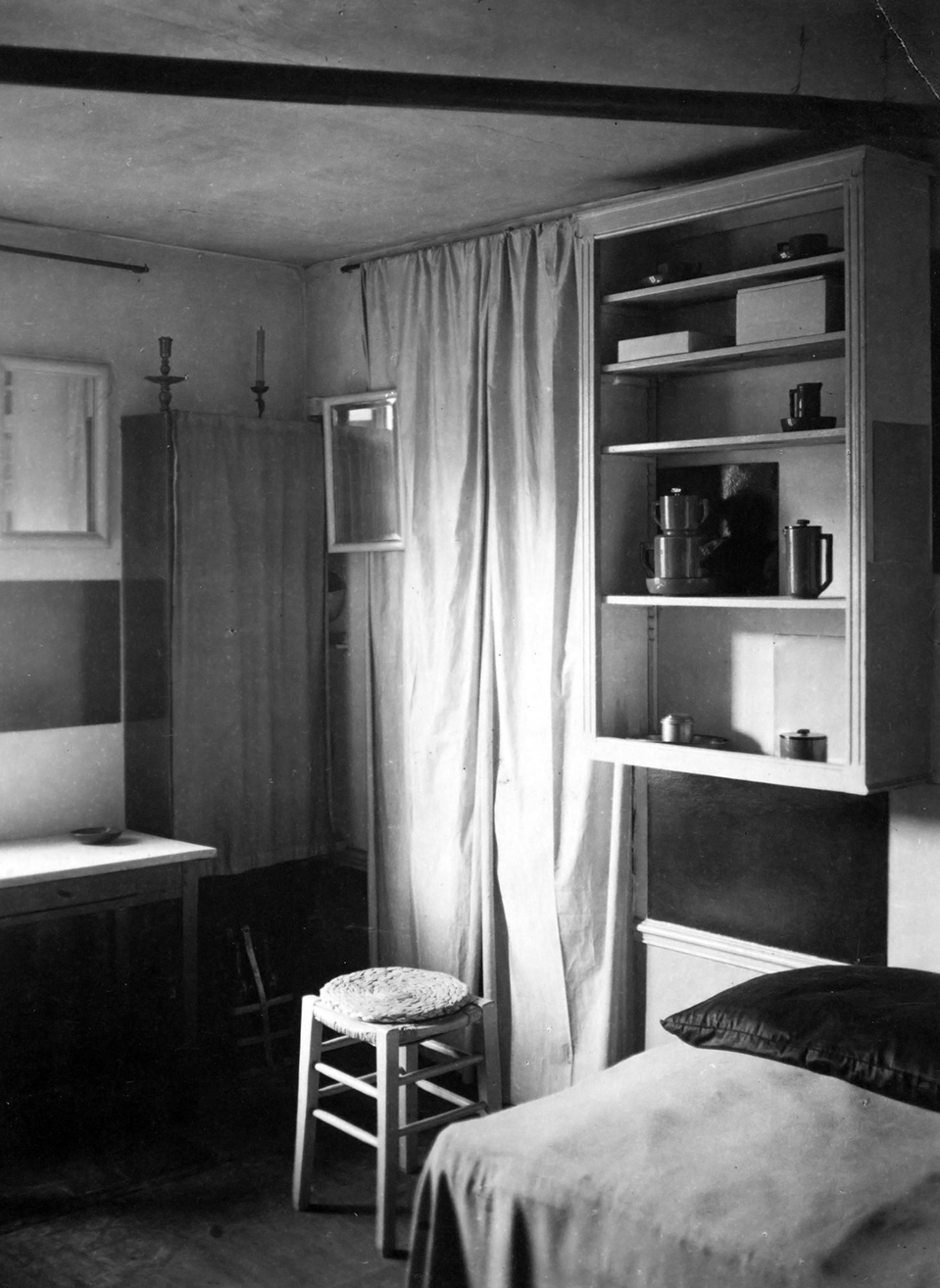 andrc3a9-kertc3a9sz-a-corner-of-mondrian_s-studio-with-bed-stool-curtain-and-mirrors-1926